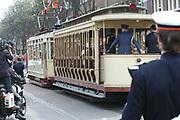On Queensday, april 30th the Queen attends the celebrations of Queensday in Scheveningen near the Hague.<br /> This is her 25th jubilee.<br /> <br /> Op Koninginnedag, 30 april, is de Koningin  's Middags aanwezig metn en haar familie het koninginnedagfeest mee te vierten in Scheveningen.<br /> <br /> On The photo / On the Photo;<br /> <br /> The Royal family leaves Scheveningen with a old Tram.<br /> <br /> De Koninklijke familie verlaat scheveningen met een oude tram.