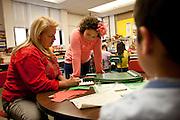 Angie Linchoten, right, gets spelling help from her teacher, Ms. Bergen, in her third grade class at Bennion Elementary School in Salt Lake City, Monday, Dec. 17, 2012.