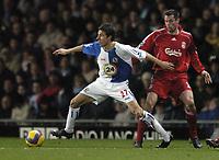 Photo: Jonathan Butler.<br />Blackburn Rovers v Liverpool. The Barclays Premiership. 26/12/2006.<br />Matt Derbyshire of Blackburn goes past Jamie Carragher of Liverpool.
