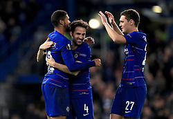 Chelsea's Ruben Loftus-Cheek (left) celebrates scoring his side's third goal of the game and his hat-trick with team-mate Chelsea's Cesc Fabregas (centre) and Chelsea's Andreas Christensen (right)