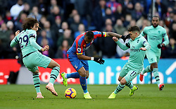 Arsenal's Matteo Guendouzi (left) and Lucas Torreira (right) battle for the ball with Crystal Palace's Jordan Ayew (centre) during the Premier League match at Selhurst Park, London.
