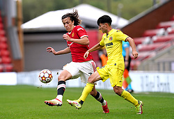 Manchester United's Alvaro Fernandez (left) and Villarreal's Rodrigo Alonso Martin battle for the ball during the UEFA Youth League, Group F match at Leigh Sports Village, Manchester. Picture date: Wednesday September 29, 2021.