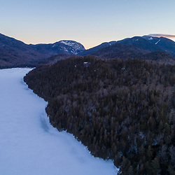 Winter dawn at Henderson Lake in New York's Adirondack Mountains. Tahawus Tract, Newcomb, New York.