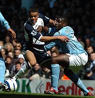 Photo: Ed Godden.<br />Tottenham Hotspur v Manchester City. The Barclays Premiership. 08/04/2006. Spurs' Jermaine Jenas (L) is held by Man City's Micah Richards.