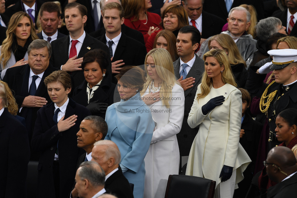 Melania Trump stands with the Trump family during the national anthem following the swearing in ceremony of her husband President Donald Trump during the President Inaugural Ceremony on Capitol Hill January 20, 2017 in Washington, DC. Donald Trump became the 45th President of the United States in the ceremony.