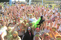 © Licensed to London News Pictures. 31/08/2014. Shepton Mallet, UK People take part in The Bristol 'Colour Me Rad' 5 km run event at Royal Bath and West showground , Shepton Mallet , Somerset. Photo credit : Jason Bryant/LNP