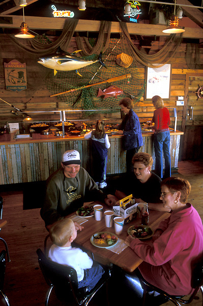 Family eating a meal at a local restaurant in Galveston Texas