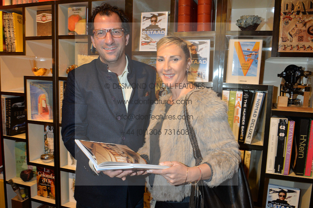 ***UK_MAGAZINES_OUT***<br /> LONDON, ENGLAND 30 NOVEMBER 2016: <br /> Left to right, Thomas Gommes, Christina Mamakos at the launch of In The Spirit of Gstaad at Maison Assouline, Piccadilly, London hosted by Mandolyna Theodoracopulos and Homera Sahni England. 30 November 2016.