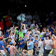 NEW YORK, NEW YORK - July 03: Wilmer Flores #4 of the New York Mets hits his second home run of the game, a two run homer in the fifth inning as the crowd in left field try to catch the ball during the Chicago Cubs Vs New York Mets regular season MLB game at Citi Field on July 03, 2016 in New York City. (Photo by Tim Clayton/Corbis via Getty Images)