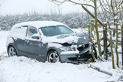 © Licensed to London News Pictures 24/01/2021, Cirencester, UK. A car on the side of the A417 near Cirencester that has spun off the road and crashed in the snow. Photo Credit : Stephen Shepherd/LNP