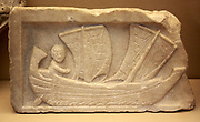 Marble relief showing a man sailing a corbita (a small coastal vessel with two masts) Roman, found at Carthage and probably made in Africa Proconsularis (Tunisia) about AD 200. The sails of the boat would probably be made of cloth, with leather reinforcements at the corners, Large amounts of trading was carried out by a small boats such as this which went from harbour to harbour hugging the coast.