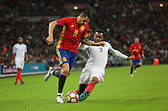 England defender Danny Rose (03) tackling Spain striker Vitolo (11) during the Friendly match between England and Spain at Wembley Stadium, London, England on 15 November 2016. Photo by Matthew Redman.
