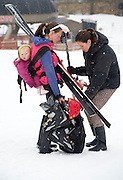 PRICE CHAMBERS / NEWS&GUIDE<br /> While lugging some gear around for her Pole, Pedal, Paddle team, Amanda Thayne gets some help from Shauna Walchenbach as Thayne's daughter hitches a ride on her mother's back Saturday at Jackson Hole Mountain Resort.