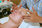 Woman receiving facial at Beauty Salon, LA, California, USA..24.8.04
