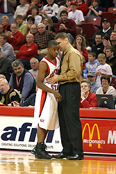 18 January 2004  Coach Porter Moser and Vince Greene have a short conference. Illinois State University Redbirds host the Southwest Missouri State Bears at Redbird Arena in Normal IL
