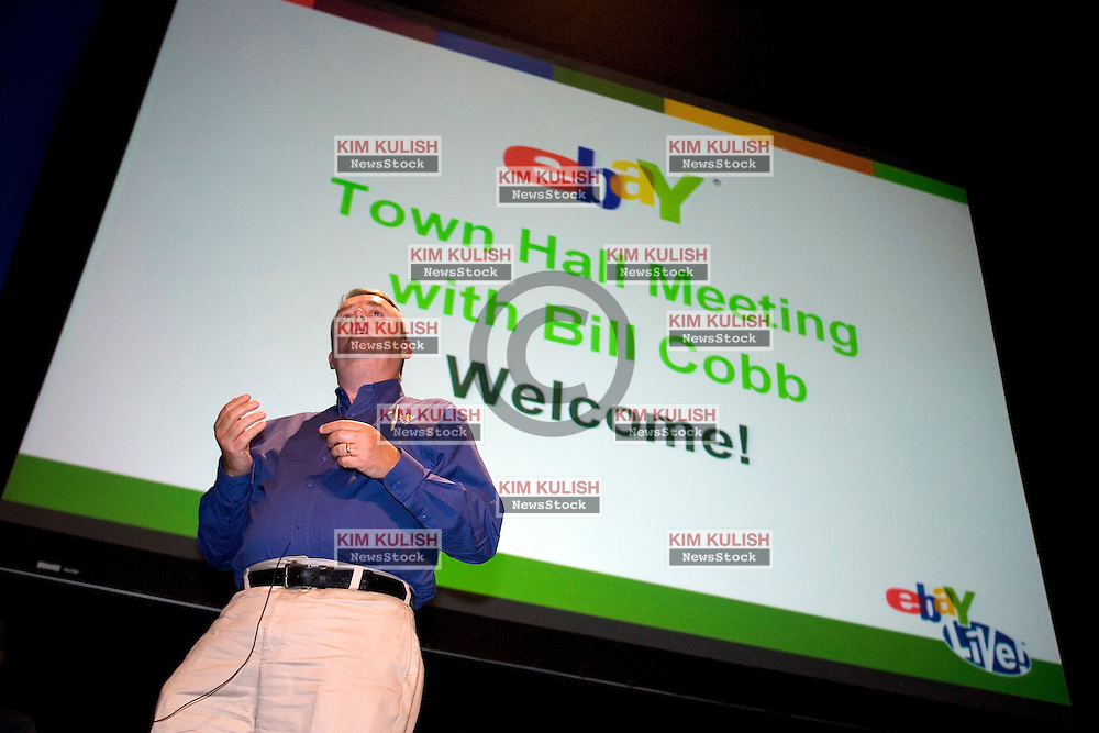 """Bill Cobb , eBay North America president  addresses the crowd during his Town Hall meeting.  Cobb and other executives fielded questions from some of the  over 10,000 of the eBay faithful gathering for eBay's 10th anniversary,   """" eBay Live! 2005"""" in San Jose,  California.  Photo by Kim Kulish"""