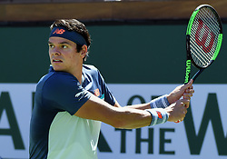 March 16, 2019 - Indian Wells, CA, U.S. - INDIAN WELLS, CA - MARCH 15: Milos Raonic (CAN) in action in the second set of a semifinals match played during the BNP Paribas Open at the Indian Wells Tennis Garden in Indian Wells, CA.  (Photo by John Cordes/Icon Sportswire) (Credit Image: © John Cordes/Icon SMI via ZUMA Press)