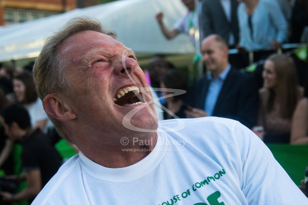 Westminster, London, June 6th 2016. A member of the House of Lords grimaces as they try to outdo their MP counterparts as teams from uk industry as well as the House of Commons and the House of Lords compete in the annual McMillan Cancer Charity tug o' war.