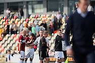 Northampton manager Chris Wilder (centre) confronts the referee Christopher Sarginson at the end of the match, while Newport manager Justin Edinburgh (far right) leaves the pitch.  Skybet football league two match, Newport county v Northampton Town at Rodney Parade in Newport, South Wales on Saturday13th Sept 2014<br /> pic by Mark Hawkins, Andrew Orchard sports photography.