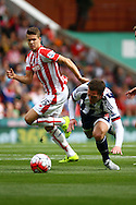Craig Gardner of West Bromwich Albion takes a tumble. Barclays Premier League match, Stoke city v West Bromwich Albion at the Britannia stadium in Stoke on Trent, Staffs on Saturday 29th August 2015.<br /> pic by Chris Stading, Andrew Orchard sports photography.