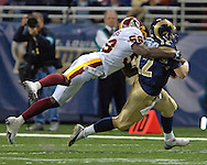 Washington Redskins linebacker Chris Clemons (R) tackles St. Louis Rams quarterback Ryan Fitzpatrick (L) for a loss in the fourth quarter, during the Redskins 24-9 win at the Edward Jones Dome in St. Louis, Missouri, December 4, 2005.