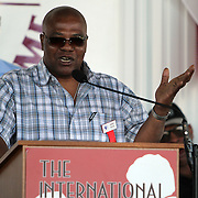 """Aaron """"The Hawk"""" Pryor laughs with the crowd during the 23rd Annual induction weekend opening ceremony at the International Boxing Hall of Fame on Thursday, June 7, 2012 in Canastota, NY. (AP Photo/Alex Menendez)"""