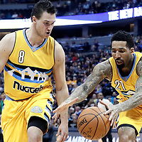 10 March 2017: Denver Nuggets forward Wilson Chandler (21) reaches for the ball next to Denver Nuggets forward Danilo Gallinari (8) during the Denver Nuggets 119-99 victory over the Boston Celtics, at the Pepsi Center, Denver, Colorado, USA.