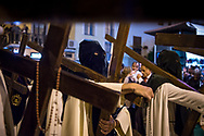 In the middle of the Holy Week processions there is always a group of people that reenact the scene of Jesus Christ carrying the cross. Seville, Spain.