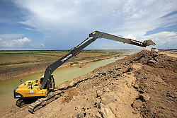 New canal digging and levee construction at Chong Kneas on the Tonle Sap lake  Siem Reap Province, Cambodia.
