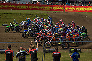 Unbelievably, French Kawasaki rider Julien Lieber (33) would not holeshot the first MXGP moto. Instead, Tim Gajser (243) and Antonio Cairoli (222) out raced everyone into the first corner, but it was Cairoli who took the official holeshot.