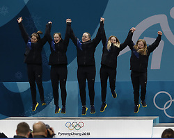 February 25, 2018 - Pyeongchang, KOREA - Sweden players including Anna Hasselborg, Sara McManus , Agnes Knochenhauer , Sofia Mabergs and Jennie Waahlin celebrate on the podium after the women's curling gold medal game during the Pyeongchang 2018 Olympic Winter Games at Gangneung Curling Centre. (Credit Image: © David McIntyre via ZUMA Wire)