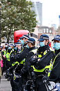 "Police form a line during a ""Match the Million"" march for free speech, free assembly, and freedom from lockdowns outside Downing Street in Central London, on Saturday, Oct 10, 2020. (VXP Photo/ Vudi Xhymshiti)"