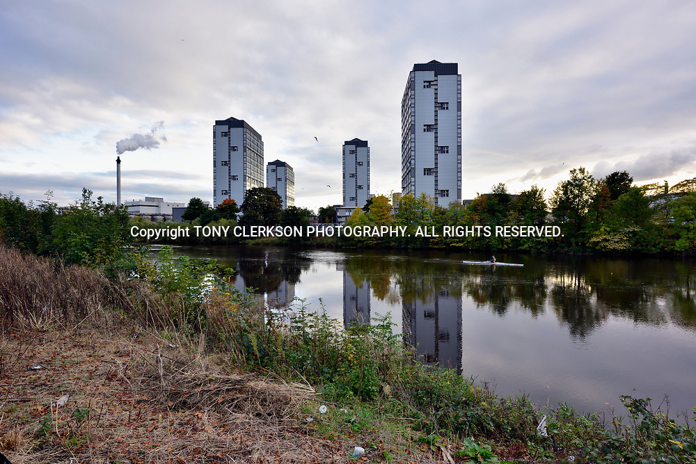 A rower glides past tower blocks in the Gorbals, Glasgow