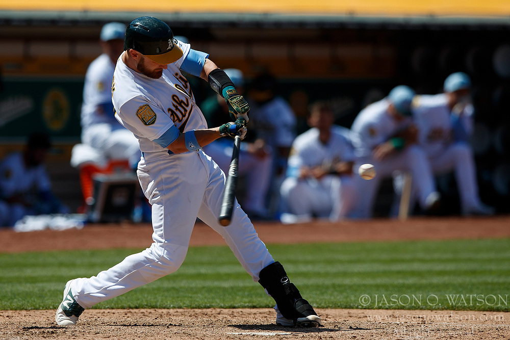 OAKLAND, CA - JUNE 17: Jonathan Lucroy #21 of the Oakland Athletics at bat against the Los Angeles Angels of Anaheim during the eighth inning at the Oakland Coliseum on June 17, 2018 in Oakland, California. The Oakland Athletics defeated the Los Angeles Angels of Anaheim 6-5 in 11 innings. (Photo by Jason O. Watson/Getty Images) *** Local Caption *** Jonathan Lucroy