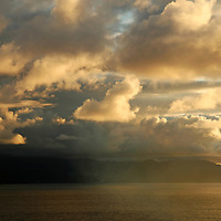 Europe, Portugal, Azores. Sunrise and clouds over the Azores islands.