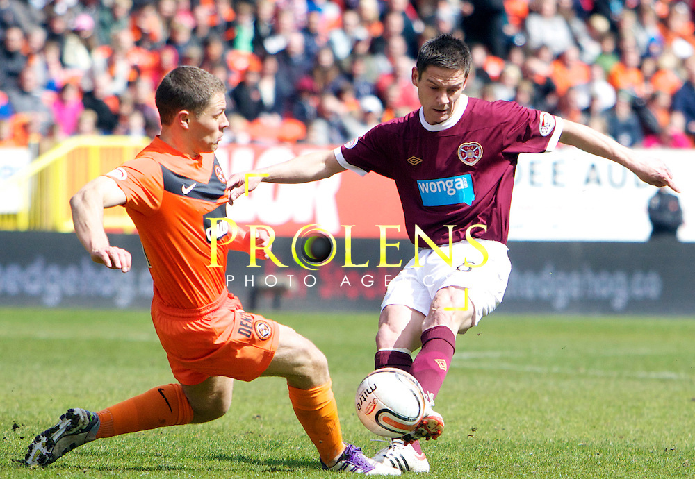 SPL Dundee United FC v  Hearts FC Scottish Premier League Season 2011-12.28-04-12...HEARTS Ian Black has a shot at goal but is blocked by United's John Rankin      during the Scottish premier League clash between Euro spot chasing Dundee United FC and Heart of Midlothian FC...At Tannadice Stadium, Dundee..Saturday 28th April 2012.Picture Mark Davison/ Prolens Photo Agency / PLPA
