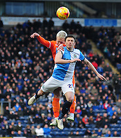 Blackpool's David Perkins vies for possession with Blackburn Rovers' Corry Evans<br /> <br /> Photographer Chris Vaughan/CameraSport<br /> <br /> Football - The Football League Sky Bet Championship - Blackburn Rovers v Blackpool - Saturday 21st February 2015 - Ewood Park - Blackburn<br /> <br /> © CameraSport - 43 Linden Ave. Countesthorpe. Leicester. England. LE8 5PG - Tel: +44 (0) 116 277 4147 - admin@camerasport.com - www.camerasport.com
