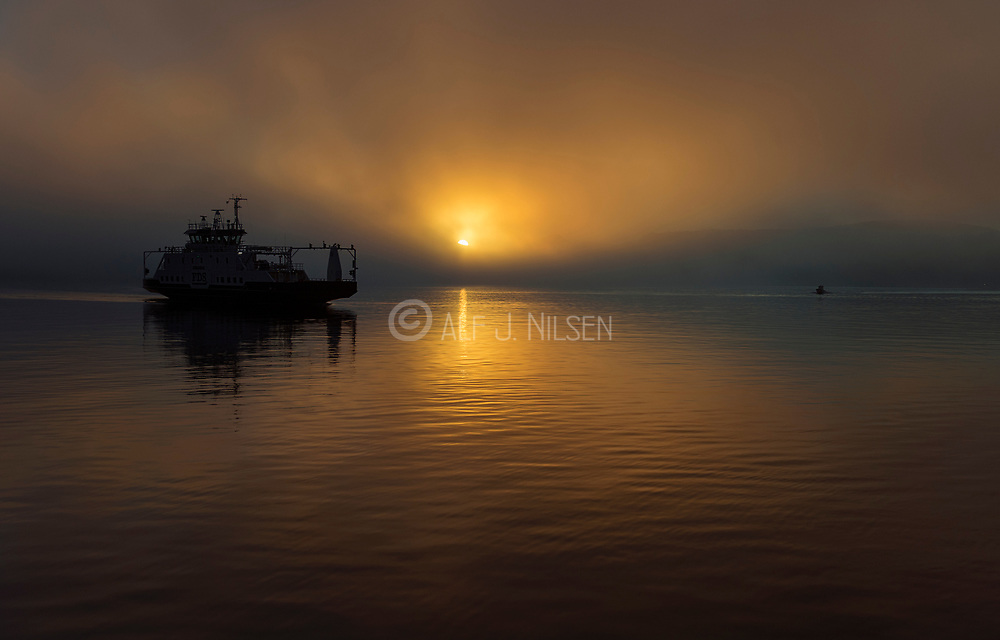 The ferry M/S Hidrasund comes in for landing at the island of Hidra (south-western Norway) on a foggy morning in March.