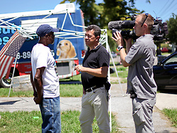 26 August 2015. New Orleans, Louisiana. <br /> Hurricane Katrina revisited. <br /> The media comes to town to investigate how the city is doing 10 years after the storm. Members of the BBC interview Robert Green, a hurricane Katrina survivor who lost his home, his grand daughter and mother to the storm.<br /> Photo credit©; Charlie Varley/varleypix.com.