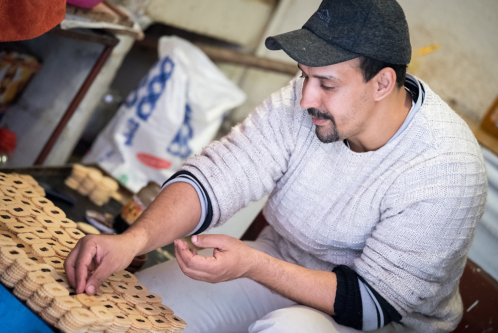12 January 2018, Marrakesh, Morocco: Baker Said at work in his bakery in the area of Aset Ihiri in the Marrakesh Medina. The Marrakesh Medina, listed as a UNESCO World Heritate site, forms an old fortified city centre of narrow streets, shops and vendor stalls. The city of Marrakesh was founded in 1070-1072, and has long been a political, economic and cultural centre.