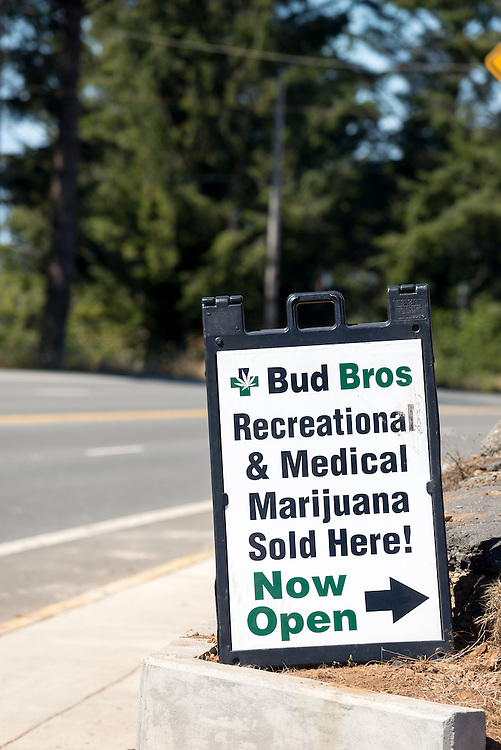 Marijuana dispensary sign on Highway 101 in Brookings, Oregon.