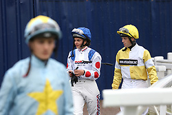 Megan Nicholls heads out to ride in the Racegoers Club 50th Anniversary EBF Novice Stakes during day two of Dubai Duty Free International Weekend at Newbury Racecourse.