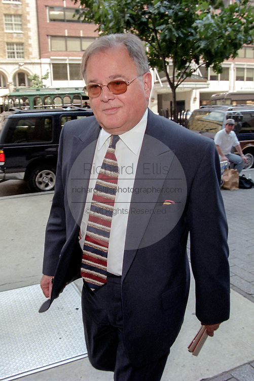 Plato Cacheris, attorney for former White House intern Monica Lewinsky, leaves the Federal Courthouse where the Grand Jury is investigating President Bill Clinton August 4, 1998 in Washington, DC.