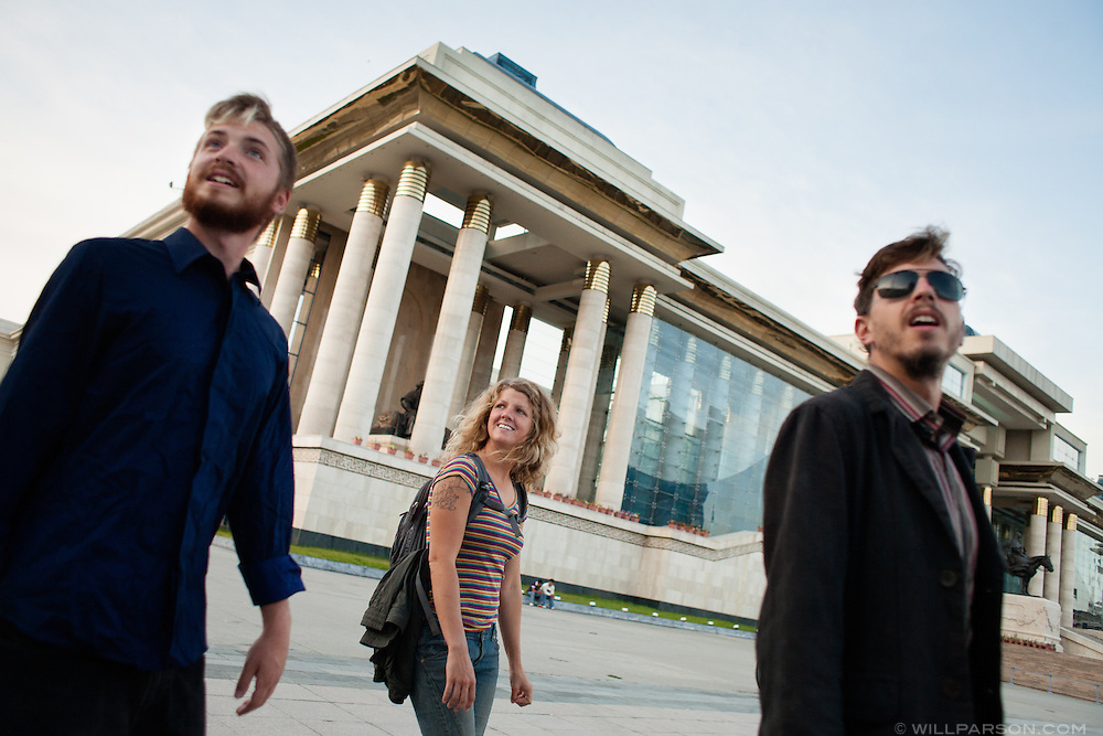 Michael Kelly, Bones Latham and Ryan Natan explore Sukhbaatar Square in downtown Ulaanbaatar after successfully reaching the Mongol Rally finish line and taking much-needed showers at a nearby hostel.