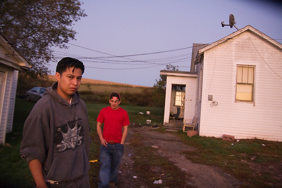 Eduardo Leon, left, picks up his friend Henry (last name not given) and others every morning on his way to work at Hudson Valley Foie Gras in Ferndale, New York on October 11, 2008. This morning, Leon had to go searching for Henry, who often oversleeps, still exhausted from his night shift at another factory.