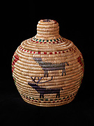 Yupik grass and seal gut basket decorated with caribou and butterflies woven by Maria George of Nightmute, Alaska. (Please note:  Licensing of this photo requires a license and additional fee to be paid to the basket's creator, Maria George)