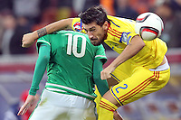 ROMANIA, Bucharest: Romania's Paul Papp (R) and Northern Ireland's Kyle Lefferty (L) vie for the ball during the Euro 2016 Group F qualifying football match Romania vs Northern Ireland in Bucharest, Romania on November 14, 2014.
