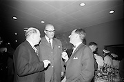 """25/03/1966<br /> 03/25/1966<br /> 25 March 1966<br /> Shock Symposium at UCD, Belfield, Dublin. The symposium on medical """"Shock"""" sponsored by Pharmacia International was held at the Department of Science at U.C.D.. Over 250 attended the symposium that was presided over by Prof. P. FitzGerald M.D., M.Ch., M.Sc F.R.C.S.I.. Picture shows (l-r): Prof. P. FitzGerald; The Swedish Ambassador H.E. Nils-Erik Ekblad who attended and one of the speakers Dr. V.F. Gruber, M.D. (Switzerland) chatting at a reception after the event."""