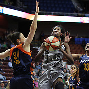 UNCASVILLE, CONNECTICUT- MAY 05:  Astou Ndour #45, (center), of the San Antonio Stars drives to the basket challenged by Kelly Faris #34, (left) and Morgan Tuck #33 of the Connecticut Sun during the San Antonio Stars Vs Connecticut Sun preseason WNBA game at Mohegan Sun Arena on May 05, 2016 in Uncasville, Connecticut. (Photo by Tim Clayton/Corbis via Getty Images)