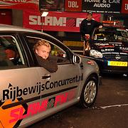 NLD/Huizen/20051129 - Slam FM organiseert een zit wedstrijd in een auto bij Coronel Kartracing Huizen, winaar krijgt een auto